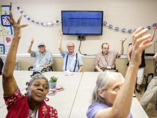Members of the Jewish Family Services' Elder Club do workout exercises during their July meetup. Elder Club is a group socialization and caregiver respite program that was established in 1999 to serve older adults.