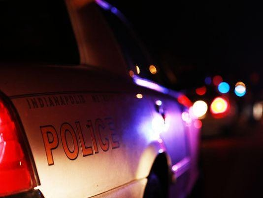 Adams police car night
