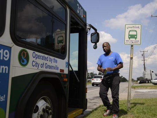 Greenville resident Ben Rice boards a Greenlink bus near his home to go to work. He pays a coworker to drive him home at night.