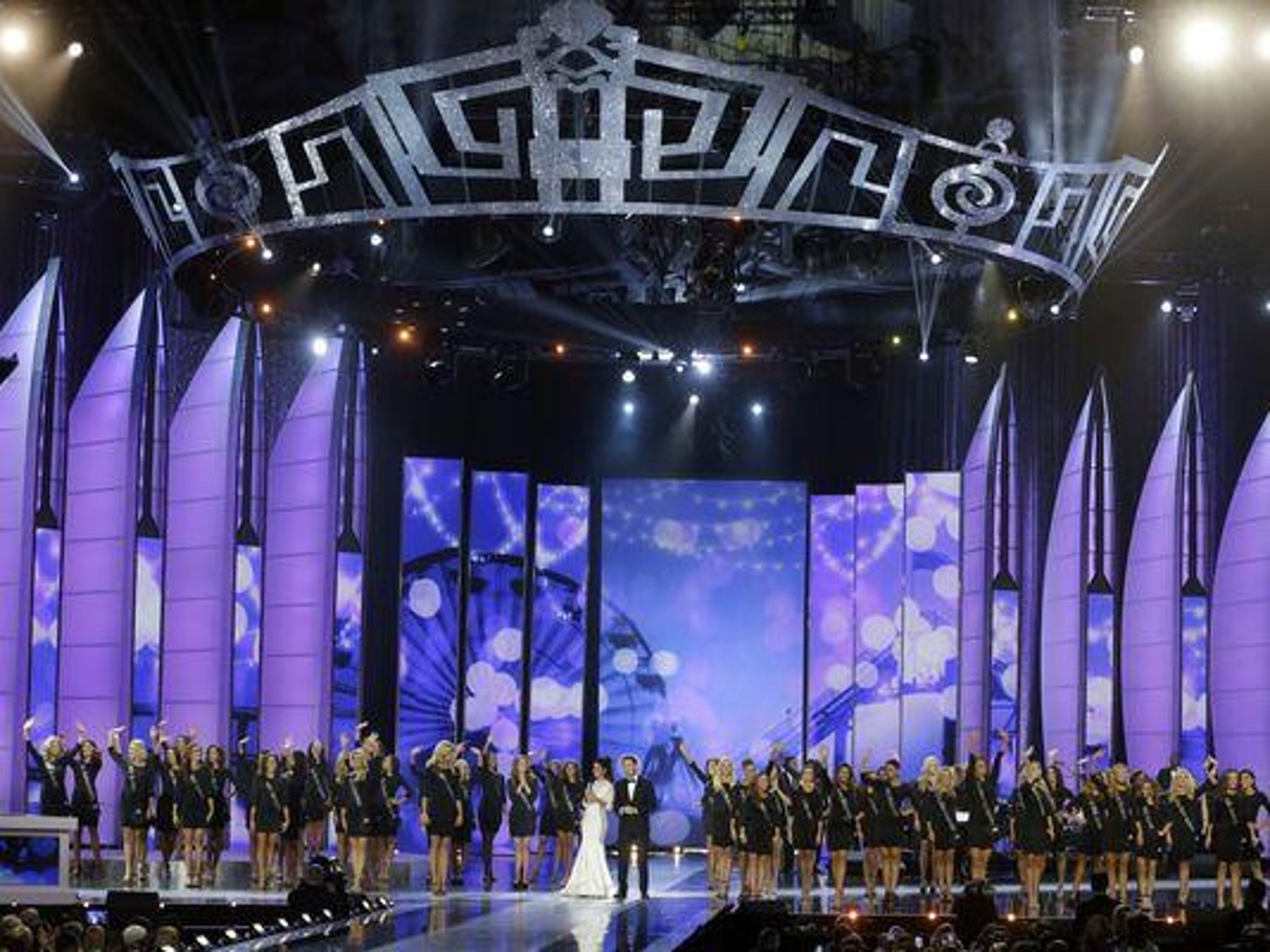 Miss America contestants stand on the stage during