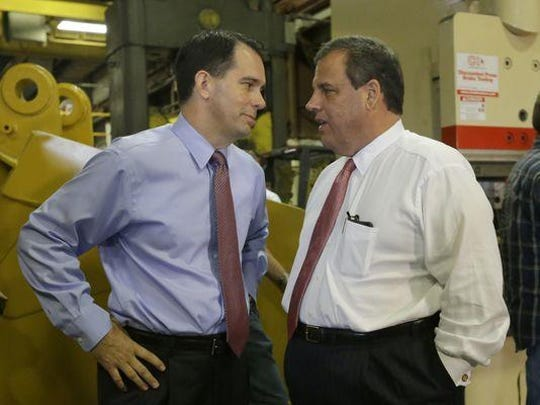 Wisconsin Gov. Scott Walker (left) and New Jersey Gov. Chris Christie in a 2014 file photograph (file photo)