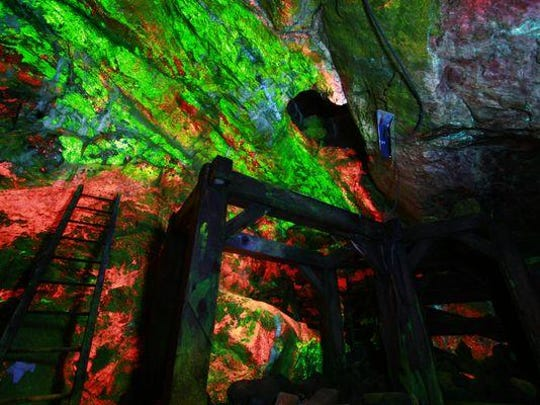 In the Rainbow Tunnel, brightly fluorescent zinc ore is exposed in the mine walls.
