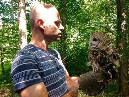 When Chris Soucy, director of the Raptor Trust, brings Vilma the barred owl out of her cage for an impromptu visit, lucky Trust guests come out of every edge of the Millington property to take a look at the permanent resident.