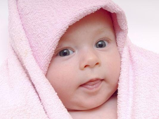 635720468503412184-Baby-in-pink-towel