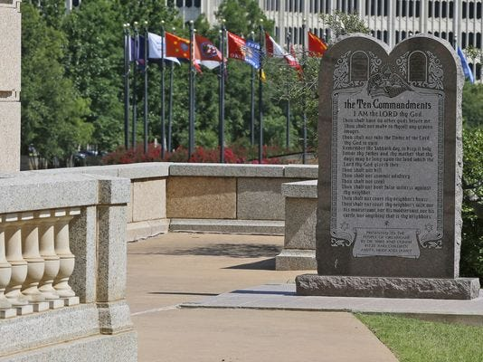 Oklahoma's Supreme Court ruled that the Ten Commandments monument on the Capitol grounds must be removed because it indirectly benefits the Jewish and Christian faiths in violation of the state constitution.