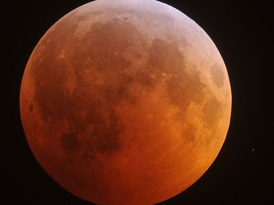 The eclipsed moon glows in the predawn sky Dec. 21, 2010, in a view from North Carolina. (AP file photo)
