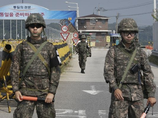 South Korean soldiers stand guard at the border.