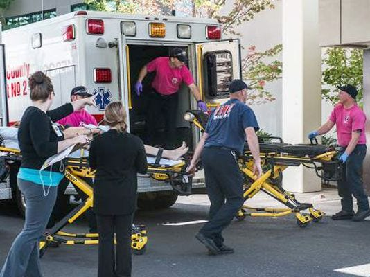 A patient is wheeled into the emergency room at Mercy Medical Center in Roseburg, Ore., following a deadly shooting at Umpqua Community College, in Roseburg.