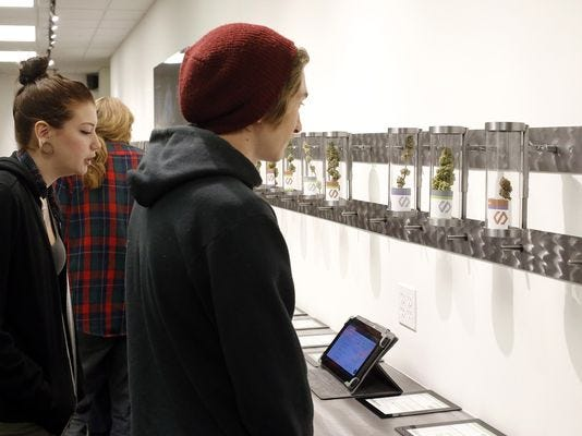 Customers look at product displays at Shango Premium Cannabis in Portland, Ore.