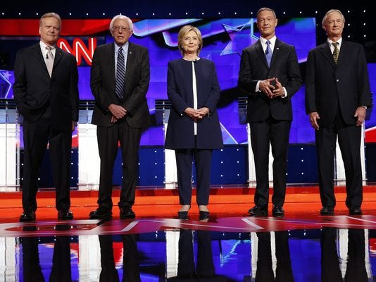 Jim Webb, Bernie Sanders, Hillary Clinton, Martin O'Malley and Lincoln Chafee during the national anthem at the start of the Democratic presidential debate at Wynn Las Vegas on Oct. 13, 2015.