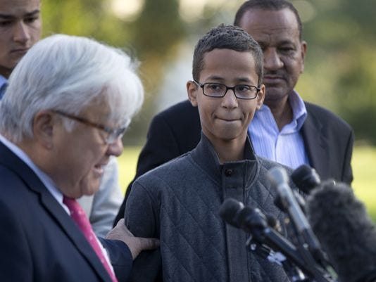 Ahmed Mohamed, second from right, listens as Rep. Mike Honda, D-Calif., left, speaks during a news conference on Capitol Hill in Washington, Oct. 20, 2015.