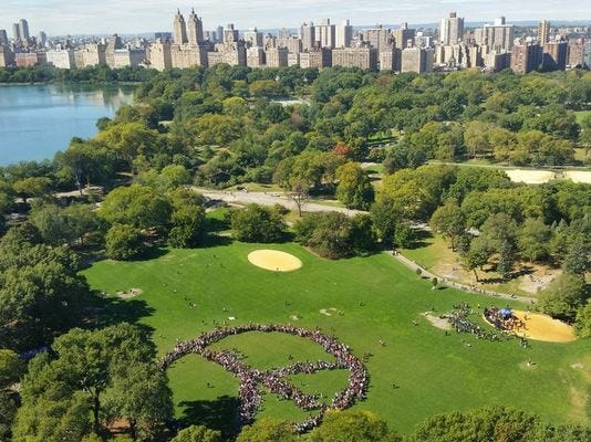 Two thousand people gathered to create a human peace sign in New York City on Tuesday.