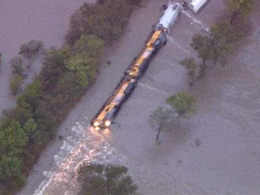 Two Union Pacific crewmembers were rescued after their freight train derailed in floodwaters north of Corsicana.