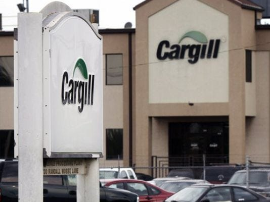 In this Aug. 4, 2011 photo, cars are parked at the Cargill Inc., turkey processing plant in Springdale, Ark. Cargill has recalled 40 of 130 workers who were laid off last summer following two recalls of ground turkey.