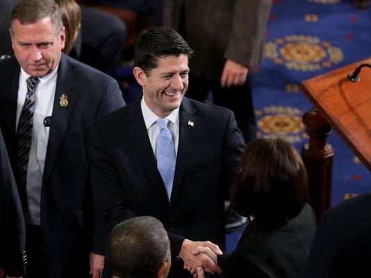 Paul Ryan greets fellow lawmakers on the House floor before being elected speaker on Oct. 29, 2015.