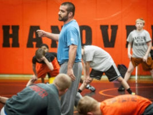 Hanover wrestling coach Kurt Brenner was approved as the school district's new athletic director. He will also continue coaching the Nighthawks.