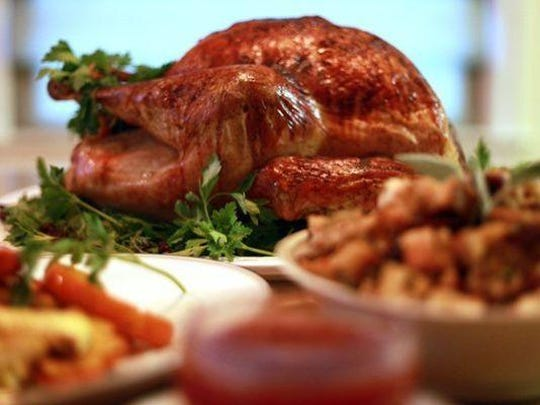 A classic roasted turkey with a cherry glaze. Pictured with it are squash wedges with parsnips and a classic bread stuffing with dried cherries and apples.