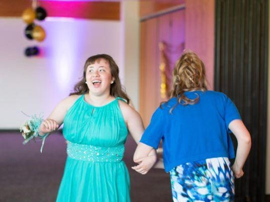 Mary Anne Muldon and Gabby Kreza share smiles at the therapeutic recreation prom.