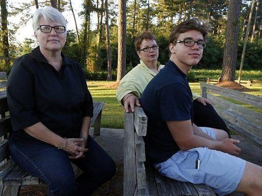 Hudson Garner, 15, with his mothers Kathryn Garner