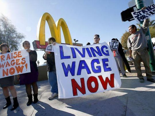 FILE PHOTO: Fast-food worker protests the past three years have helped drive a movement to raise wages to $15 an hour in several states and cities.