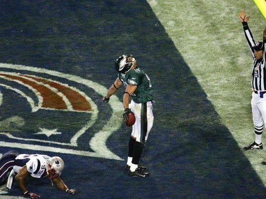L.J. Smith celebrates his Super Bowl touchdown catch for the Philadelphia Eagles against the New England Patriots.
