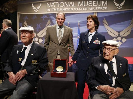 The two remaining members of the Doolittle Tokyo Raiders, Staff Sgt. David Thatcher, front left, and Lt. Col. Richard Cole, right, meet with Lt. Gen. John Hudson, rear left, director of the National Museum of the U.S. Air Force, and Air Force Material Commander Gen. Janet C. Wolfenbarger in 2015. Thatcher died in Missoula in 2016.