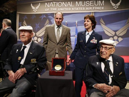 The two remaining members of the Doolittle Tokyo Raiders, Staff Sgt. David Thatcher, front left, and Lt. Col. Richard Cole, right, meet with Lt. Gen. John Hudson, rear left, director of the National Museum of the United States Air Force, and Air Force Material Commander Gen. Janet C. Wolfenbarger in 2015. Thatcher died Wednesday at age 94.
