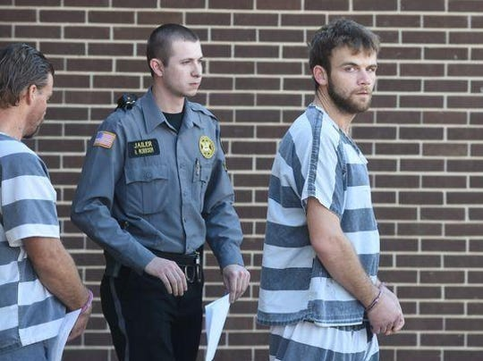 Terry Lynn Teeter Jr., right, walks out of the Baxter County Court Annex after a hearing. Teeter, who is serving a 10-year-prison sentence for killing 22-year-old Christopher Jordan, was recently denied parole and will not be eligible again until November of 2019.