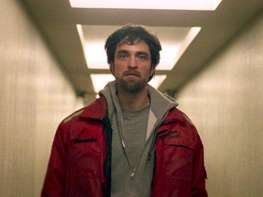 Robert Pattinson plays lowlife bank robber Connie Nikas