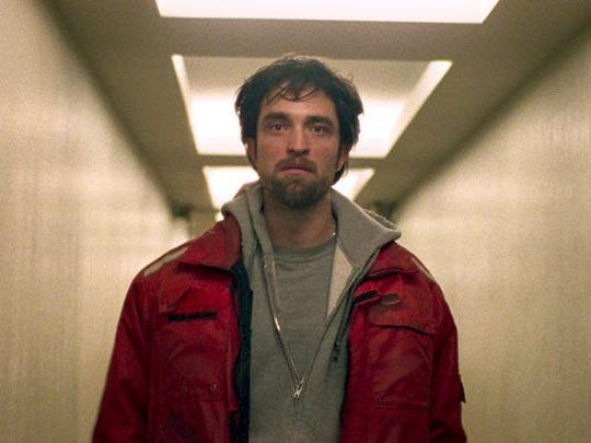"Robert Pattinson plays lowlife bank robber Connie Nikas in ""Good Time."""