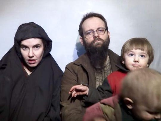 Caitlan Coleman, Joshua Boyle and their children are seen in a video released by the Taliban in 2016.