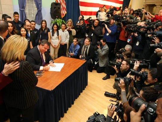 Gov. Chris Christie ceremonially signs the DREAM Act after meeting with Hispanic community leaders in Union City on Jan. 7.