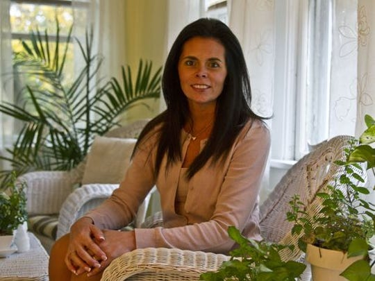 Anysia Kiel, a healing medium and author, sits in her office at Soul-Centered Healing, Toms River.