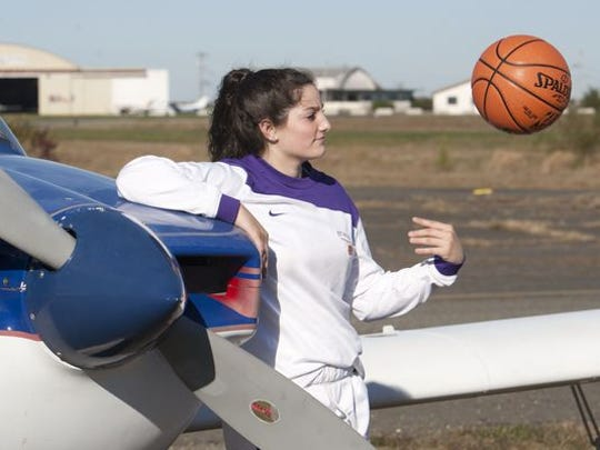 Girls high school basketball player Jess Louro of St. Rose at Wall Airport.