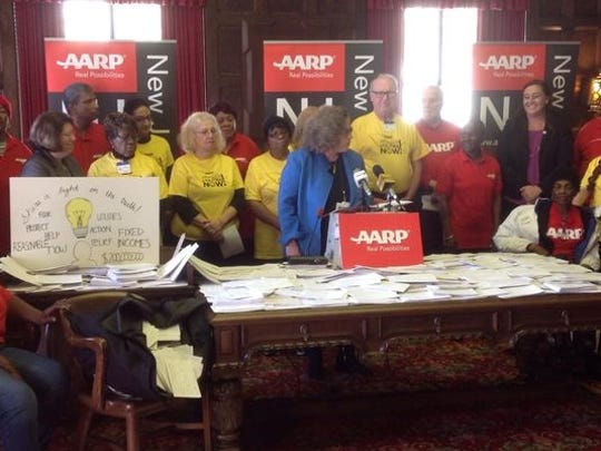 AARP officials display petition cards that were delivered to the state Board of Public Utilities on Wednesday demanding JCP&L cut its rates.