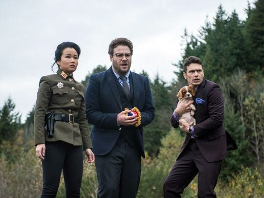 """From left: Diana Bang, Seth Rogen and James Franco in a scene from the controversial comedy """"The Interview."""""""