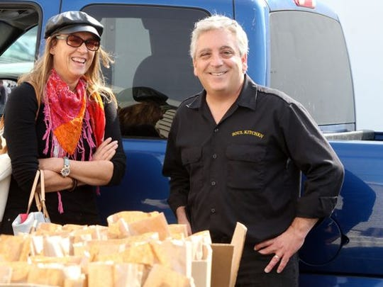 Dorothea Bongiovi, wife of Jon Bon Jovi, and (right) Lou Morreale of Long Branch, general manager of the JBJ Soul Kitchen in Red Bank, talk together while attending a lunch donated by JBJ Soul Kitchen to promote volunteerism on the second anniversary of Sandy in Union Beach.