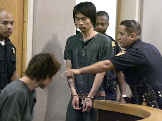 Zeng Liang Chen, 20, is direceted by a Sheriff's Officer past Dong Biao Lin, 24, at they make their initial appearance in Judge Thomas Scully's courtroom in Freehold Friday morning. The judge raised the bail to $4 million cash only for the pair who are charged with the Wednesday murder of Yao Chen, 39, and his sister, Yun Juan Chen, 28, in Freehold Borough.