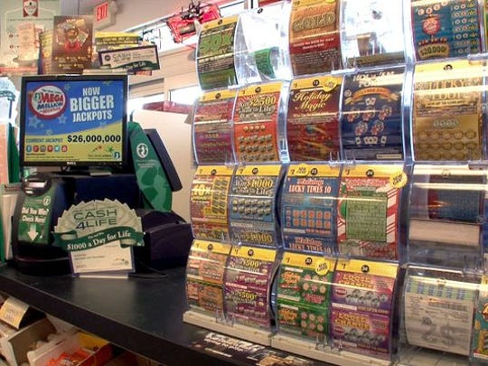Lottery tickets are shown inside the Wine World in Manchester Township on Friday, Nov. 14, 2014.