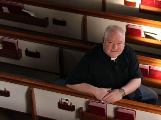 Rev. Doug Brown, who leads Asbury Park Community Church UCC, a welcoming LGBT church, poses inside the Ballard United Methodist Church in Asbury Park.
