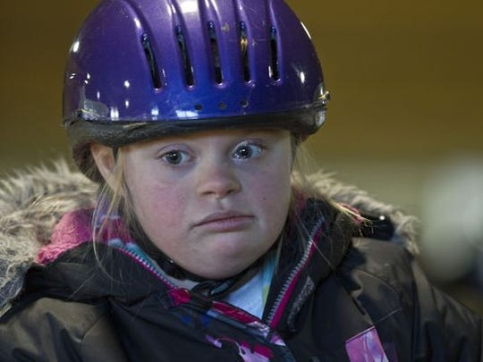 Allie Burton, 11, of Brick, has Down syndrome and autism. She attends equestrian instruction at Celtic Charms in Howell.