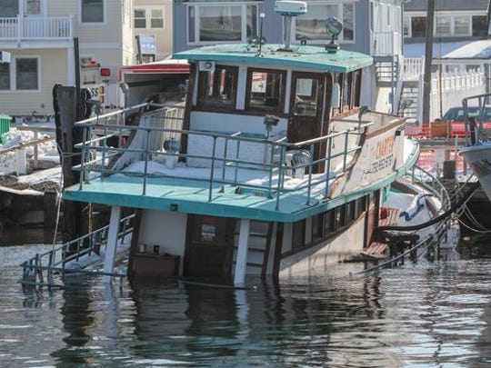 The aging party fishing boat the Norma K II sinks dockside in Point Pleasant Beach. This is the same place the Miss Point Pleasant sank in the fall. Both boats are steeped in Jersey Shore party boats fishing history.