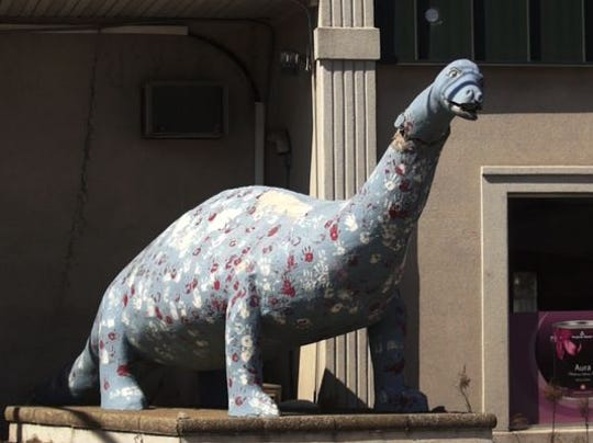 This is how the Bayville dinosaur looked before repairs began.