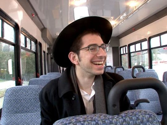 Yaakov Rosenberg, Lakewood, takes a ride on Lakewood Township's new shuttle bus Thursday, March 26, 2015.