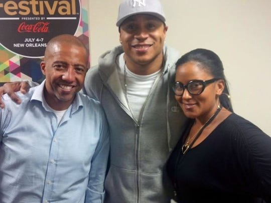 Amber Noble Garland stands with LL Cool J, one of the many musicians she's marketed at Def Jam Recordings. The man standing to the left is Kevin Liles, the former President and CEO of Def Jam, who brought Amber to the company.