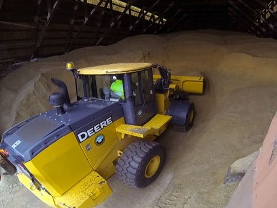 A dozer digs into the salt pile at the Monmouth County