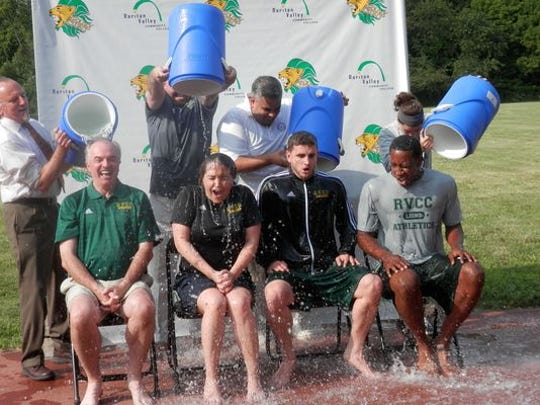 Raritan Valley Community College Chillin' 4 Charity challenge participants included back row from left: RVCC Vice President for Finance and Facilities John Trojan, George Eversmann, Matthew Ruiz and Andrea Davison; bottom row from left: RVCC President Michael J. McDonough; Director of Athletics Amanda DeMartino, Men's Basketball Head Coach Kevin Ryan and Marvin Crawford.