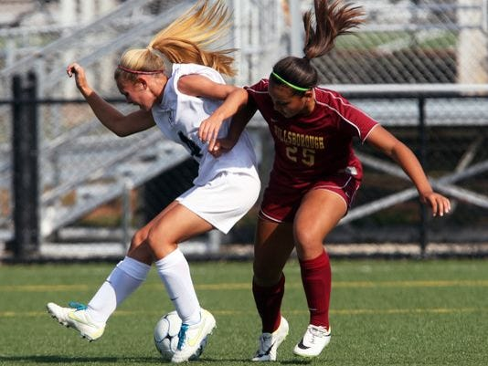 Bridgewater-Raritan's Kelsey Coulter (left) vies for control of the ball wit.jpg