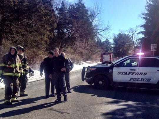Police block Oak Avenue near the scene of a reported