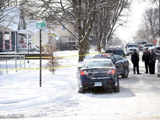 Burlington Police Department stand near the scene of a shooting Tuesday, Jan. 6, 2015, in Burlington. The Iowa Division of Criminal Investigation says the Burlington Police Department responded to a domestic dispute. Authorities say the response resulted in a shooting that left Autumn Mae Steele dead.
